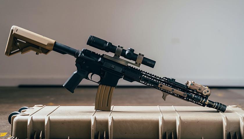 Assault Rifle on top of gun case
