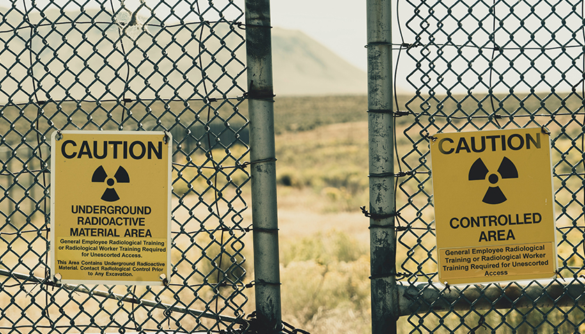 Radioactive Caution Signs on fence