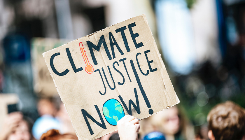 """Sign that says """"Climate Justice Now!"""""""