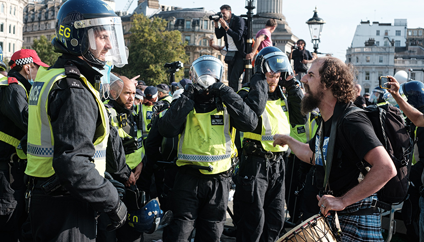 Group of police controlling riot