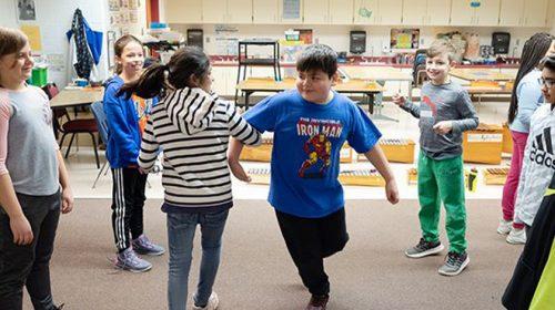 Students dancing in classroom