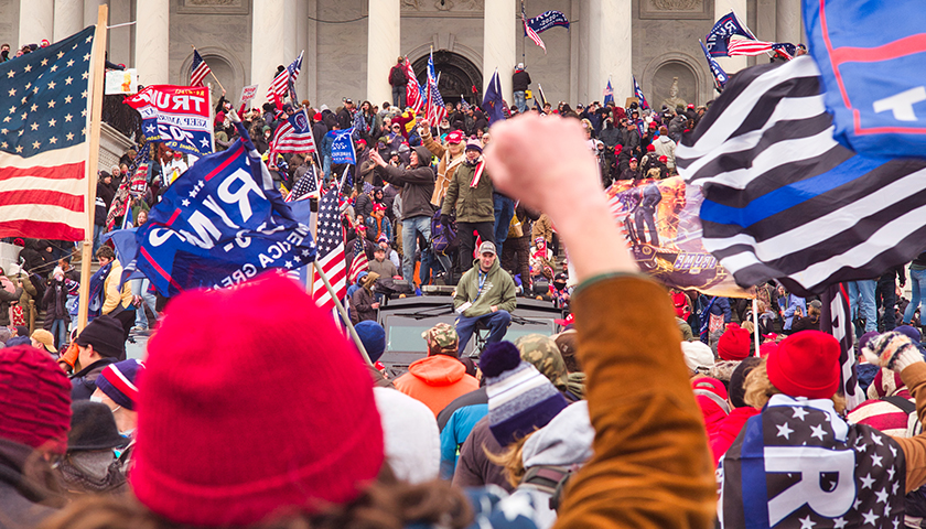 January 6 riot at the capitol with large crowd of people.