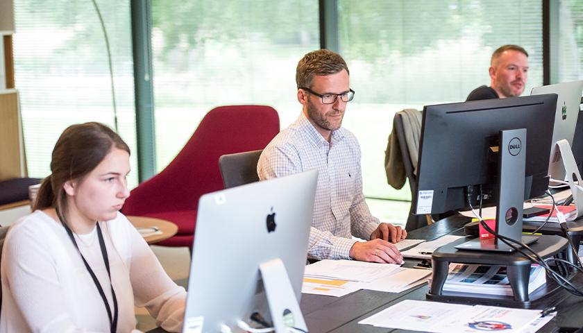 People working on desktop computers