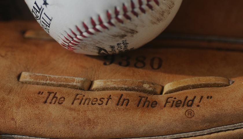 Close-up of a baseball mitt and ball