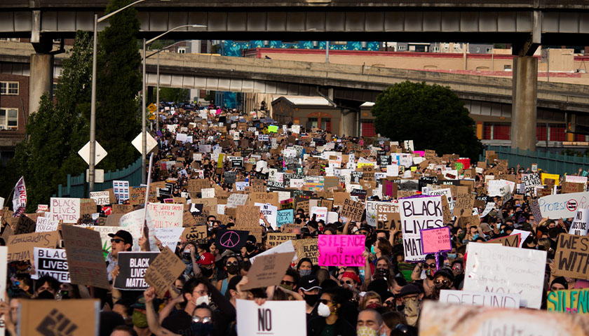 Crowd of people in the streets, protesting and Black Lives Matter movement