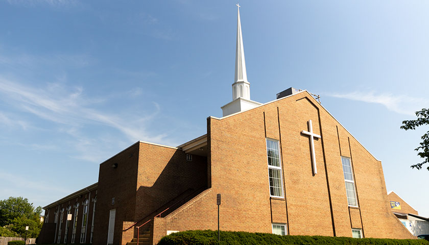Shot of a brick church with blue sky
