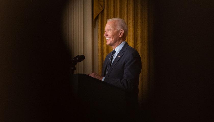Joe Biden smiling at crowd