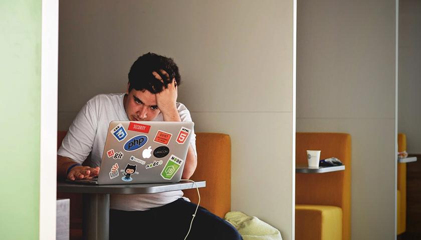 Man on macbook working