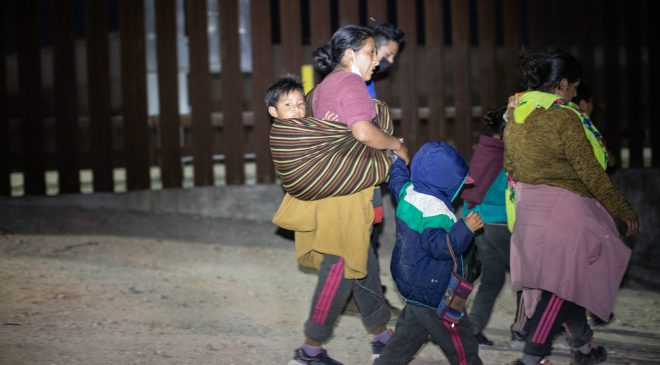 A group of migrants sought out law enforcement officials so they could turn themselves in and try to apply for asylum near the Hidalgo Point of Entry on August 9, 2021. (Kaylee Greenlee – Daily Caller News Foundation)