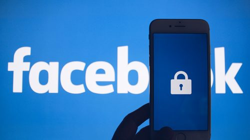 Facebook logo with smartphone showing lock in front