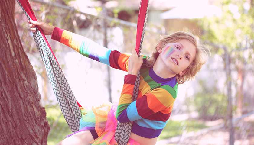 Bink, a gender non-conforming 10 year old child playing outside.